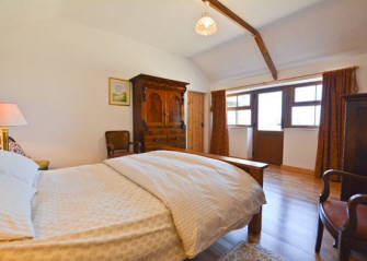 Lovely double bedded room at Curlew Cottage self catering accommodation, holiday cottage near Hexham and Corbridge in Northumberland North East England.  It has en suite shower, w.c., and handbasin.  There  is underfloor heating throughout the cottage.